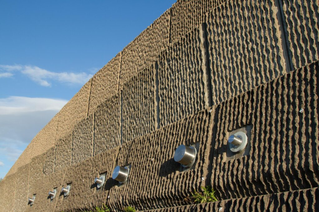 a wall with circular stainless steel