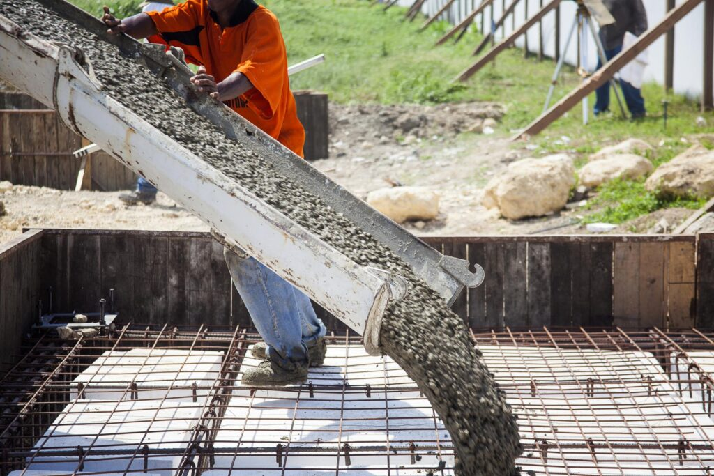 a mixer truck pouring concrete